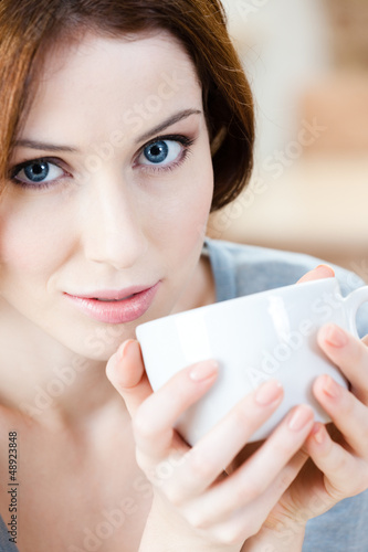 Woman with cup of tea has a rest at the cafeteria