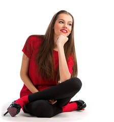 Beautiful young woman sitting on the floor