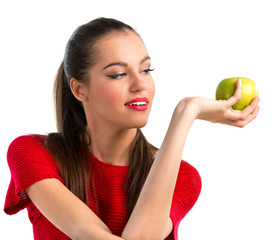 Young beautiful woman holding an apple
