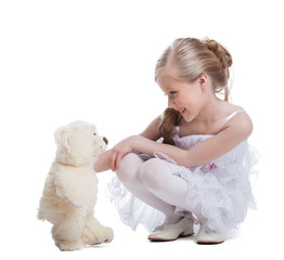 Cute little girl with soft toy
