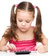 Little girl is using calculator