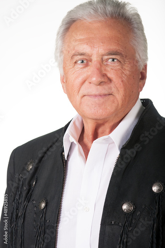 Senior citizen portrait in black leather jacket