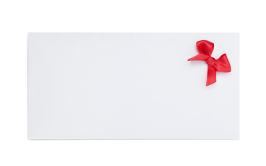 Envelope with red ribbon bow, isolated on white