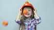Orange rain. At the head of child falling tangerines