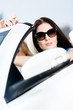 Close up of pretty female driver in the white cabriolet