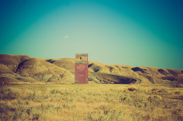 grain elevator on lonely road - Drumheller Alberta - LOMO
