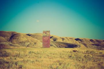 grain elevator on lonely road - Drumheller Alberta - LOMO