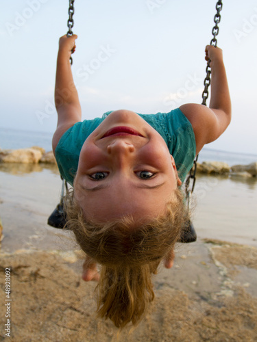 Summer joy - lovely girl playing on the beach