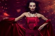 Beautiful vampire woman in red dress