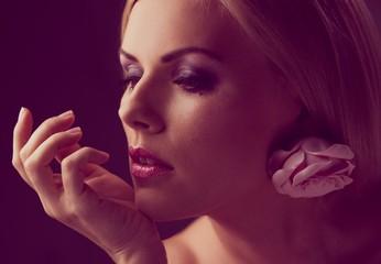 Portrait of a beautiful woman with rosebud earring