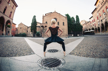 Young beautiful ballerina posing in front of St. Stephen church.