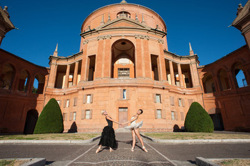 Young beautiful dancers in front of San Luca church. Italy