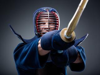 Close up of kendoka training with shinai