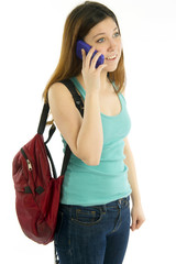 Student with backpack talking on cellular phone