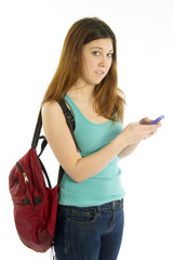 Student with backpack texting cellular phone