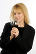 Blond executive woman toasts wine glass provocative expression