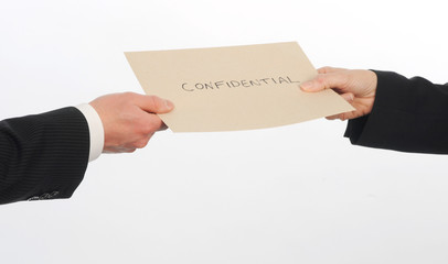 Executives exchange envelope containing confidential information