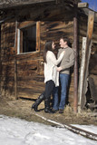 old barn with a young couple in love