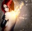 Nude beautiful woman in fire