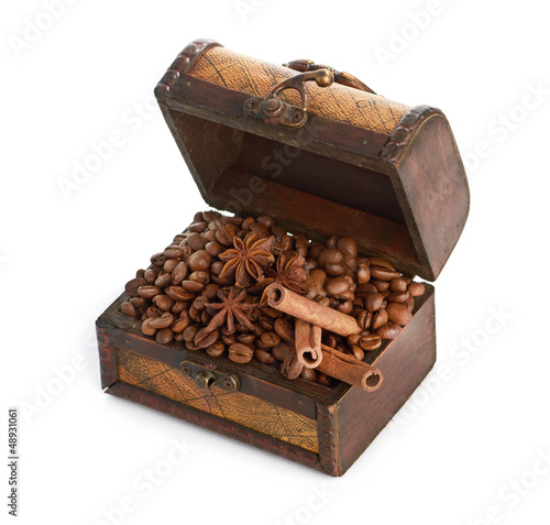 coffee beans and cinnamon sticks inside a  chest