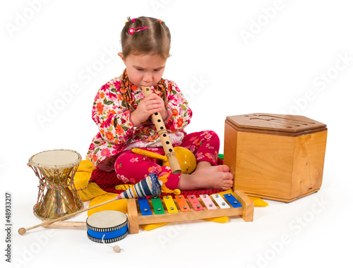 One small little girl playing music.