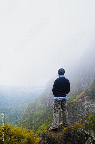 Young man in foggy mountain