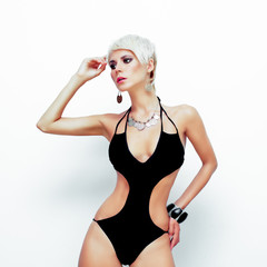 Fashion portrait of a young woman in a black swimsuit