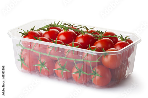 Cherry tomatoes on a branch in retail packaging