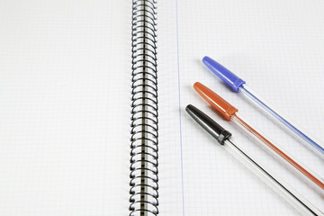 Three basic color pens on a notebook