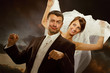 Wedding couple have fun. Smiling bride and groom imagine driving