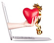 hand with a heart - gift and laptop