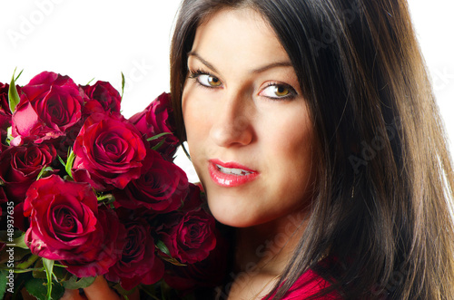 Beautiful happy woman with red roses