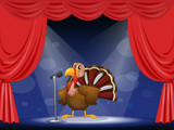 A turkey in the center of a stage