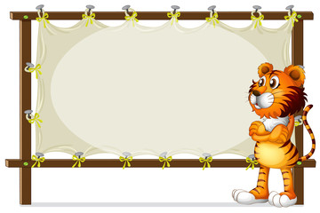 A tiger standing beside a wooden frame