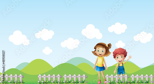 A girl and a boy in a mountain scenery