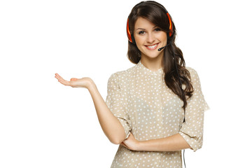 Smiling woman in headset holding empty copy space on open palm