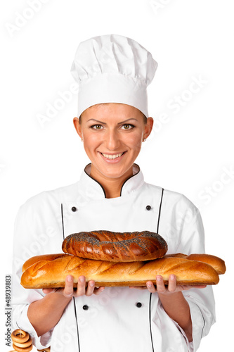 Cute female Chef baker or cook holding up a beautiful loaf  Brea