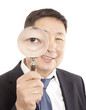 Businessman looking  a magnifying glass
