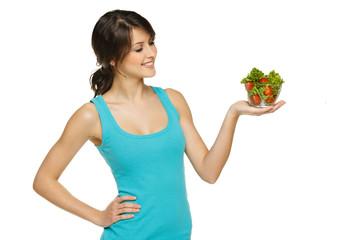 Beautiful woman holding transparent bowl with salad