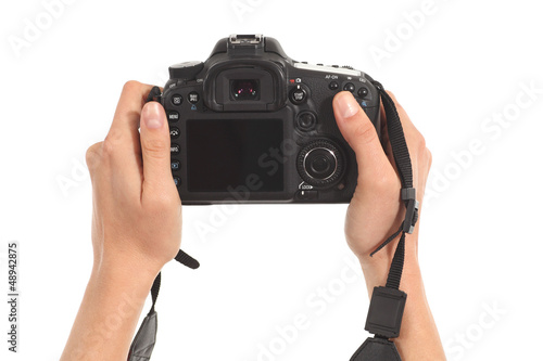 Beautiful woman hands holding a dslr camera