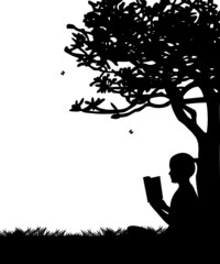 Girl reading a book under the tree in spring in park silhouette