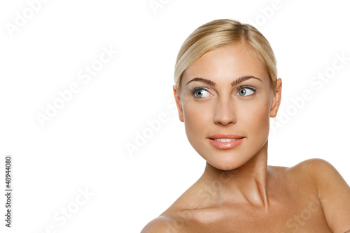 Closeup of beautiful blond female model looking to the side