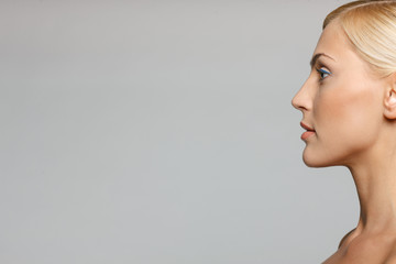 Cropped picture of side view closeup of blond woman