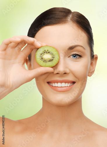 woman with kiwi slice