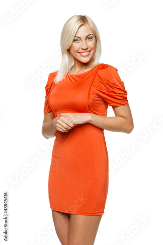 Young smiling woman in bright orange dress