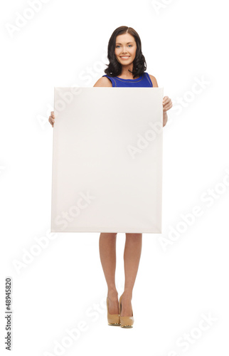 lovely woman in blue dress with blank board
