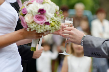 Bride holding a glass of champagne