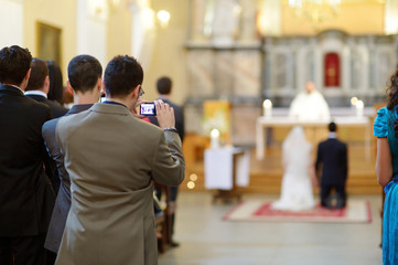 Wedding guest taking photos