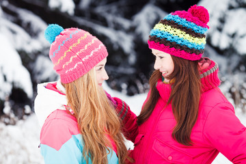 Two Young Beautiful Girls in winter outdoors