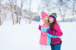 Two young girl friends in winter outdoors. Holidays. Happy Teens